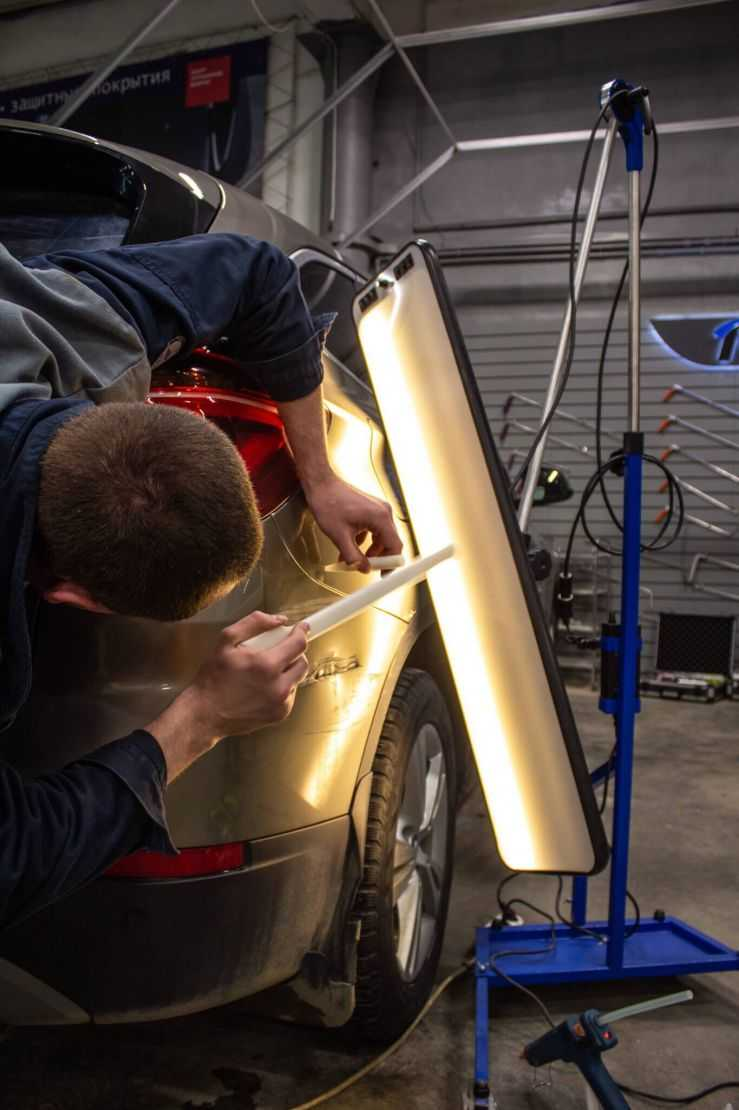 Выпрямление вмятины на кузове без покраски